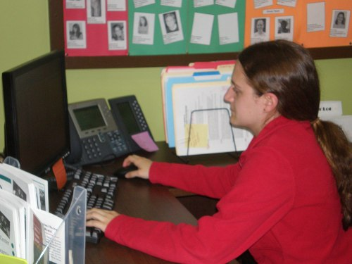 Chelsea Krieger works in the Kernodle Center recording the number of students who took a Safe Ride the previous weekend.