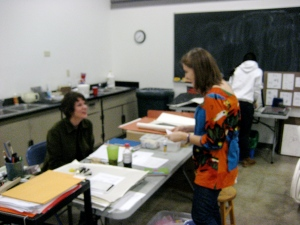 Judy Henriks talks to a student about final projct