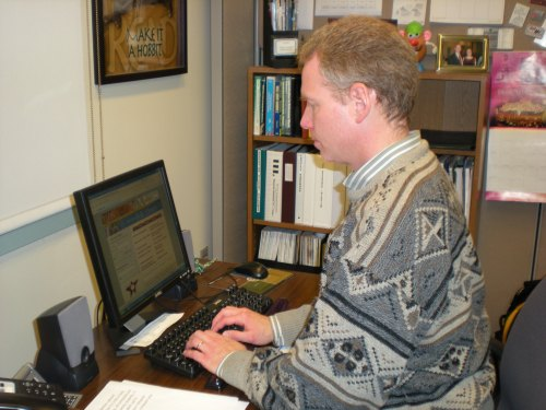 Bowman works at his computer in Belk Library.